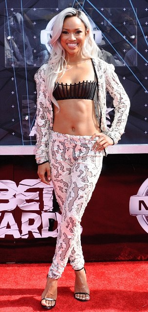 Chris Brown's ex-girlfriend Karrueche Tran went for a monochrome mermaid inspired look that showed off her taut midriff