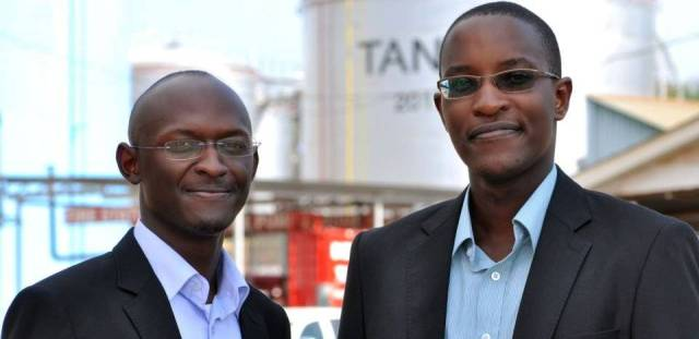 Henry (L) and Jesse (R), the first beneficiaries of the AMO Graduate exchange programme from TOTAL Uganda