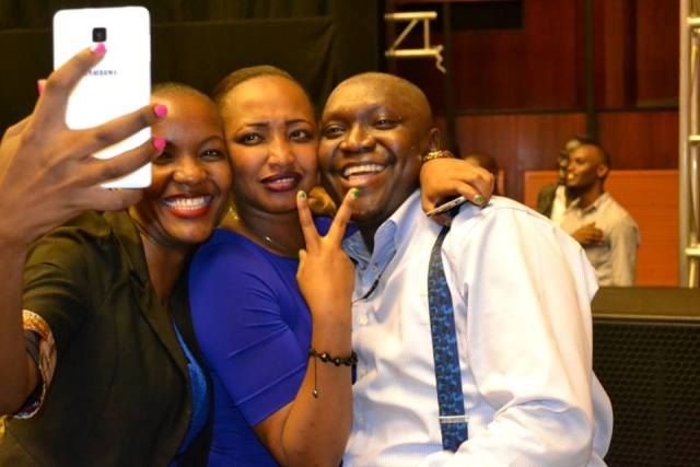 Patrick Idringi Salvado pose for a selfie with fans
