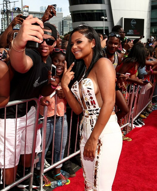 The Dip It Low hitmaker  Christina Milan flashed a peace sign as she posed for selfies with adoring fans
