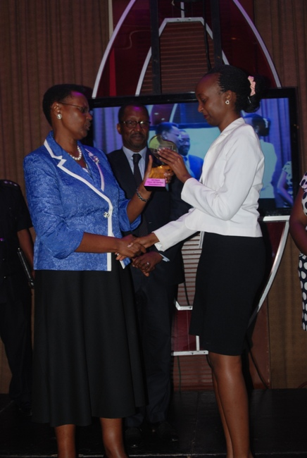 First Lady Janet Museveni hands over an award to one of the winners