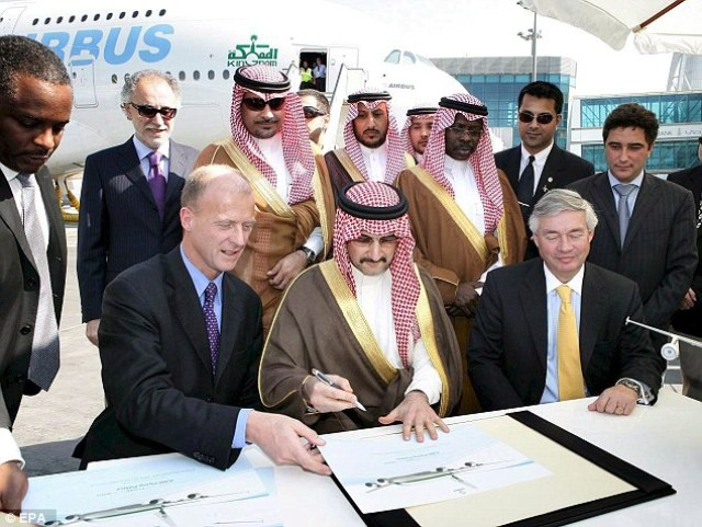 The 60-year-old businessman is pictured signing a firm order with Airbus for an A380 Flying Palace in 2007. He became the first customer for the VIP version of the new double-deck airliner