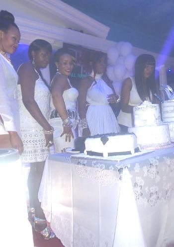 Desire prepares to cut the cake with her friends