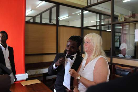 Guvnor and lover showing off their marriage certificate