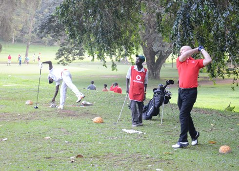 Vodafone CEO Allan Richardson teeing off the first ball to start the golf tournament at Golf Course last friday. Vodafone sponsored six ladies to train for free the golf game