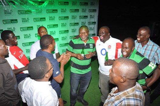 Sam Namanya of the Uganda Rugby Federation picks his reward for predicting the England win from Uche Unigwe the Heineken GM for EA