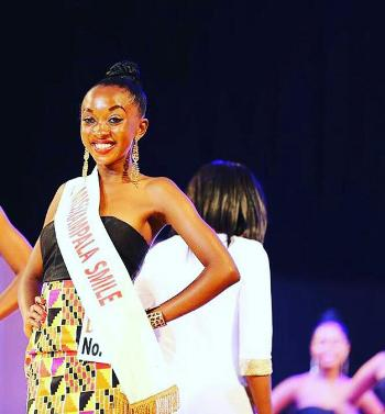 Jenny Kembabazi posting with her crown