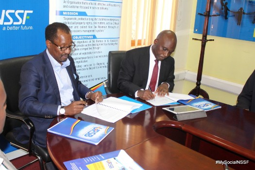NSSF MD Richard Byarugaba signs the MoU with Registrar General Bemanya Twebaze at the URSB head office at Georgian House