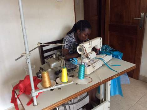 Nambi Clothing & Textile employee busy doing her work at their office in Munyonyo