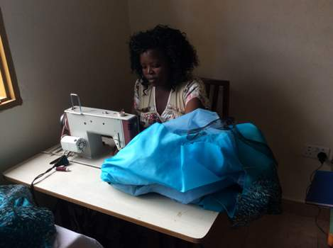 One of Brenda Nambi's workers busy at work
