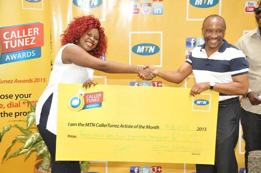 Rema receives a dummy cheque of Shs2.5m