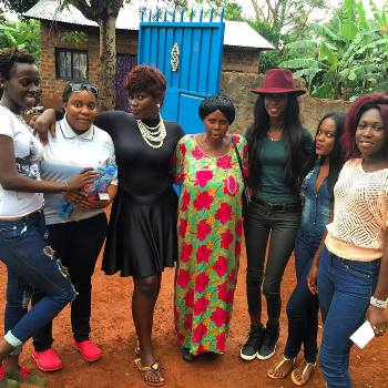Socialite and fashionista Judith Heard (3rd from the right) with some of the school stuff and her team
