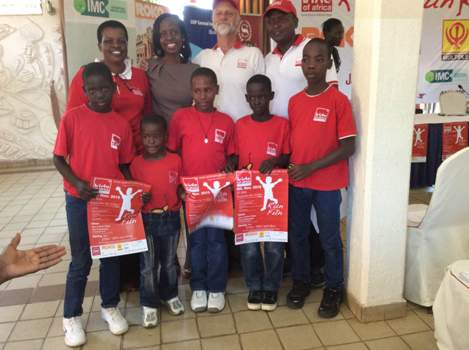 Some of the kids of Africa pose with their bosses and ROKO Construction Secretary and Human Resource Manager Diana Nyakato (2nd L) back row