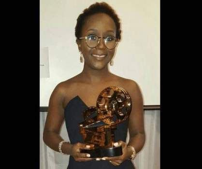 Anne Kansiime pose with her African Oscar award