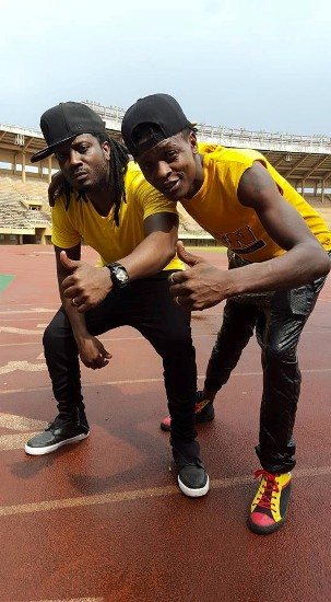 Bebe Cool and Jose Chameleone cheering NRM party
