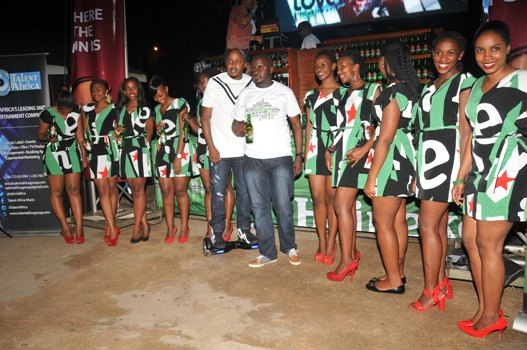 Heineken National Sales Manager, Nathan Akandwanaho with the ushers of the night