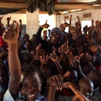 Judith  Heard with kids at Kapeeka Junior School in Luweero