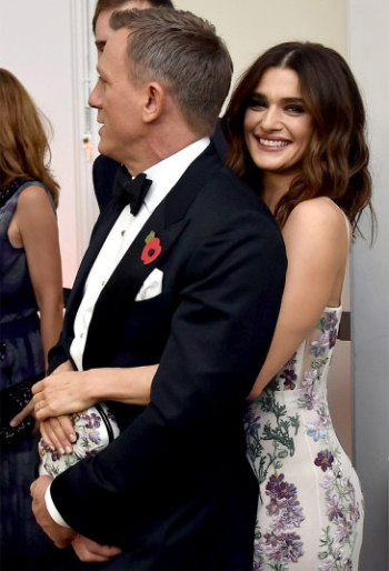 Rachel Weisz gave her husband a cheeky cuddle as they waited in line to meet the royal guests