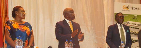 Amama Mbabazi (C) with his daughter and Norbert Mao at Serena on Sunday