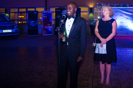 Heineken National Sales Manager Nathan Akandwanho gives his speech as British High Commissioner Alison Blackburne looks on