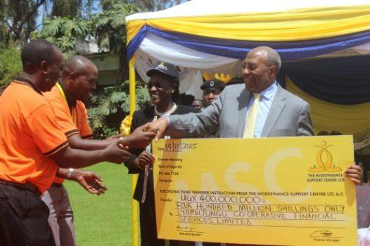 PM Rugunda & Chair MSC board Bagyenda hand over dummy cheque on Saturday in Kabale (Photo by PMPU)