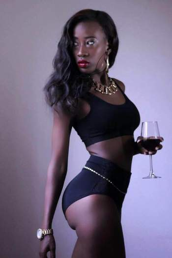 She holds a wine glass as she posed for the latest photo shoot