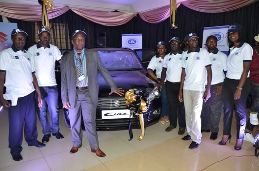 The Cooper Motor Corporation Country Manager launches the Suzuki Ciaz with his team at their new Suzuki showroom in industrial area