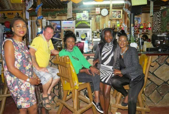 Entebbe Safaris Bar staff ready to serve customers