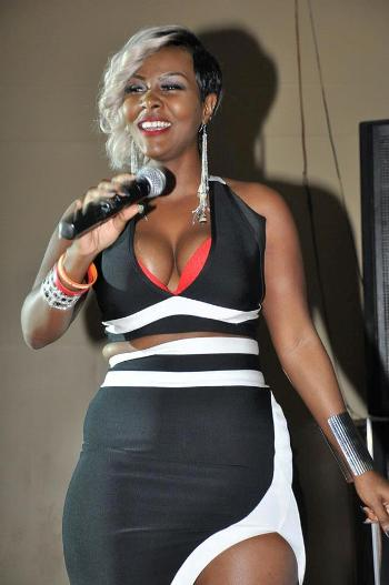 Desire showing off her boobs in Mbarara