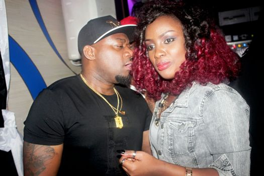 Gitawo whispering to Leila Kayondo as they partied together