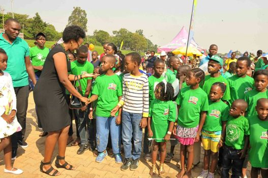 Natasha Karugire greeting some of the kids at the party