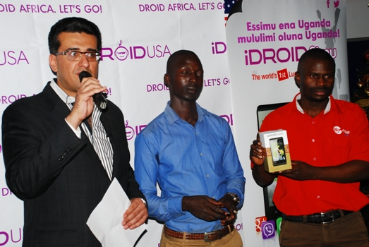 iDROID co-founder  and CEO Jawad Qureshi (L) speaking at the launch of the phone today at Simba Telecom, Kampala Road