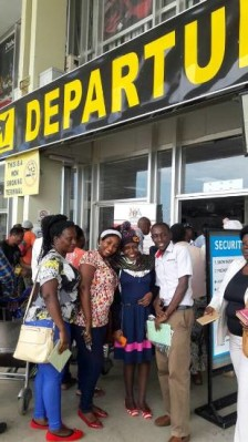Carol Atuhirwe (2nd R) at Entebbe Airport Departure Lounge
