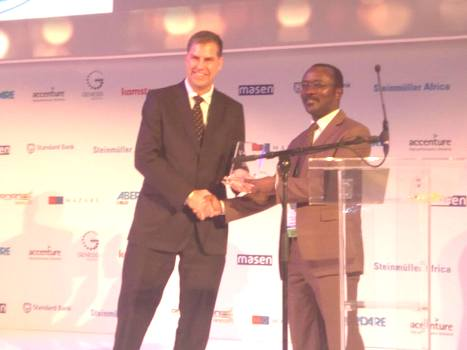 NWSC MD Dr Silver Mugisha receives the award last night in Cape Town