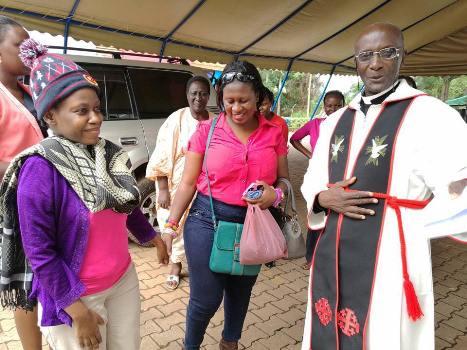 Carol Atuhirwe (L) at All Saints Church Nakasero today