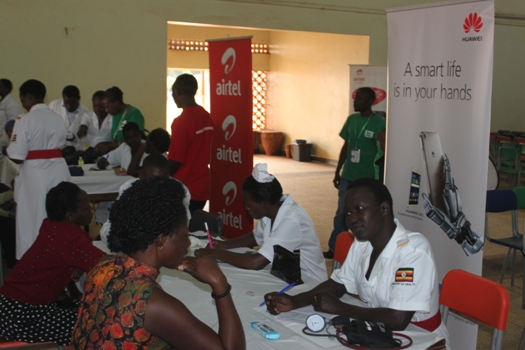Health Workers attending to patients at the Airtel - Huawei Health Camp organised by Hinds Feet Project