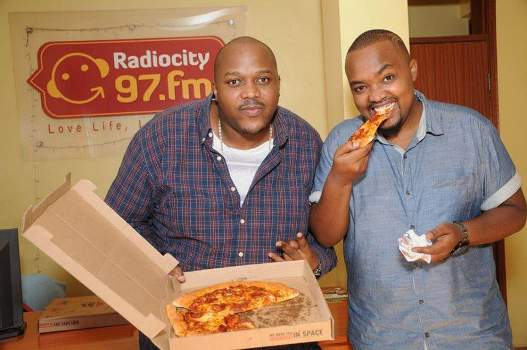 The Mith and Bryan Mckenzie, the ambassadors of Pizza Hut Uganda are currently delivering free pizzas to people in Kampala ahead of official launch on Monday