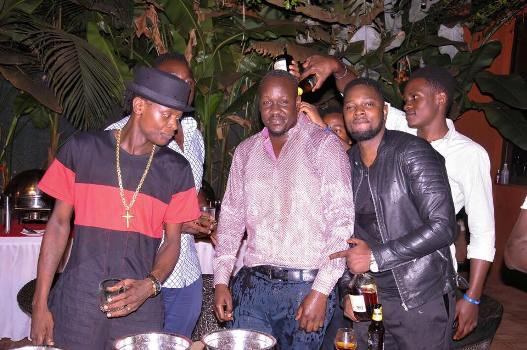Opio (C) with Chameleone and Onyango Gareth