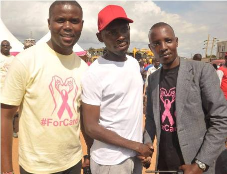 SK Mbuga (C) is involved in lots of Charity work