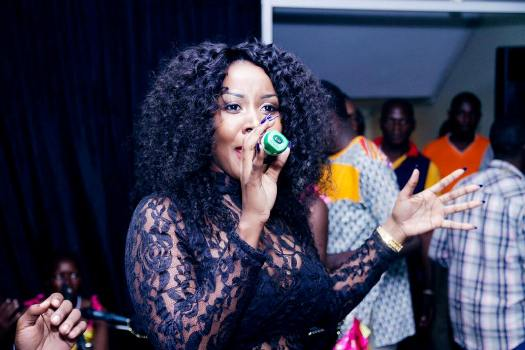 Desire Luzinda performing at the launch of Zziwa Hair Studio