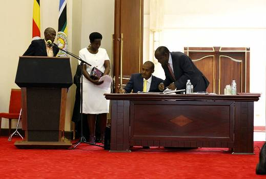Hon Frank Tumwebaze signs after his swearing in yesterday