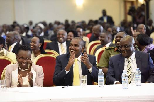 Frank Tumwebaze (C) with other members of Cabinet