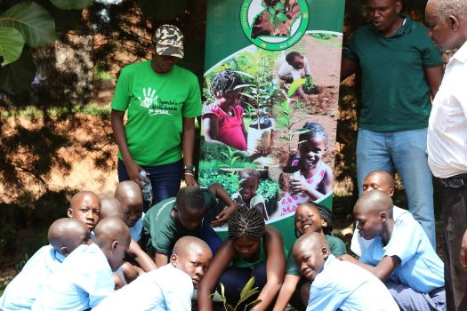 Children participate in tree planting to mark World Environment Day