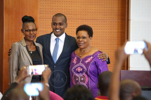 Esther, Kamya and Frank pose after hand over ceremony