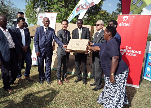 Hon John Nasasira, the Minister of ICT receives 30 PCs from Huawei Managing Director Stanley Chyn (Left)