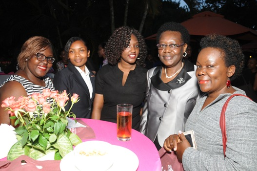 Ms. Irene Mulyagonja, the Inspector General of Government (IGG) is flanked by young women eager to learn from her personal experiences at the launch of My World, a female mentorship program. Spark TV has developed a 1 hour reality show from this mentorship program to allow viewers experience the journey of the mentors/mentees