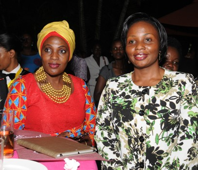 Rehmah Kasule, Founder- CEDA International and Aggie Asiimwe Konde, Managing Director-NTV/Spark TV Uganda listen to proceedings at the launch of My World, a female mentorship program. Spark TV has developed a 1 hour reality show from this mentorship program to allow viewers experience the journey of the mentors/mentees