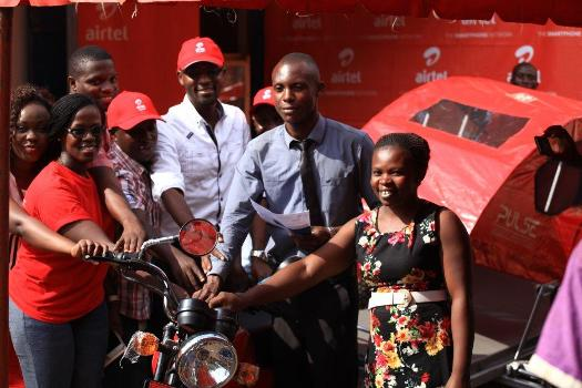 The Airtel Uganda Team led by Territory Business Manager Nathan Balinda (Centre) hand over a bike ambulance to Bulambuli health centre officials