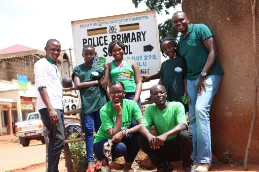 Uganda's Lilttle Hands Go Green crew pose after tree planting exercise