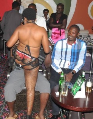 MP Moses Balyeku excited as the bikini dancer attacks his coleague